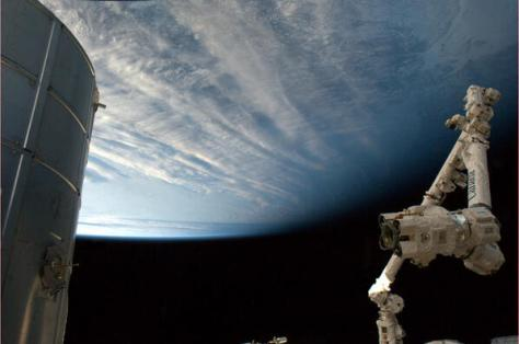 "Cmdr_Hadfield: 18 hrs~""Tonight's finale: Canadarm2, poised on the edge of night. Big day tomorrow! """
