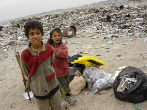 Forced to dig through garbage to help make a living for their families. Photo from UN.